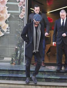 Casual: The handsome star looked stylish in relaxed skinny jeans with lace-up boots and a smart winter coat