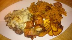 Boneless thighs with creole stuffed mushrooms,  mamposteado rice and sweet plantains
