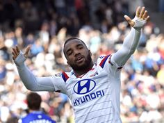 Lyon's French forward Alexandre Lacazette celebrates after scoring