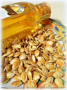 Honey Roasted Pumpkin Seeds  ~ I tossed some fresh pumpkin seeds with oil olive & roasted in a 350 degree oven for 25 minutes, stirring occasionally. Then tossed with honey & salt and roasted for 5 more minutes. When I took the seeds out of the oven I sprinkled them with a little sugar. My son has been munching on them all afternoon & says he can't stay away. So, I can safely say they are really good! :)