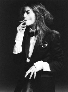 Black bow tie, white shirt and black pants... cigarette... Damn...