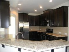 Timberlake Tahoe Maple Espresso Cabinets. Giallo Ornamental Granite. This  is our new kitchen. We have a gas cooktop and