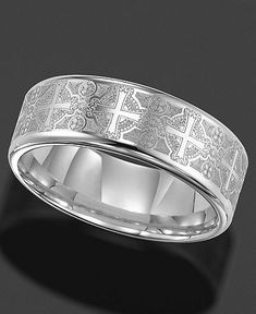 Classic, historical style. This tungsten carbide wedding band by Triton features an intricate laser-etched cross design and smooth, comfortable fit. Approximate band width: 8mm. Sizes 8-15. | Photo ma