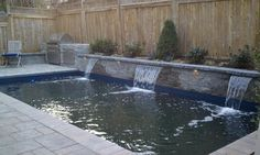 Outdoor Kitchens For Small Yards | Pool and outdoor kitchen in a row house backyard. traditional pool