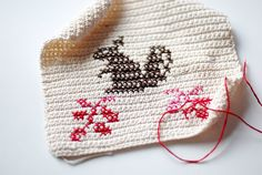 cross stitched squirrel pot holder in process. <3 How to Cross-Stitch on Single Crochet Tutorial here: http://www.craftstylish.com/item/8065/how-to-cross-stitch-on-single-crochet/page/all - heart pot holder here: http://www.crochet-world.com/newsletters/talkingcrochet/pages/TCNL1309_patt2.html