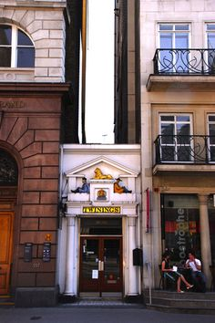The tiny Twinings Teashop, The Strand, London ...look carefully at the pavement and you will see the mosaic welcome mat