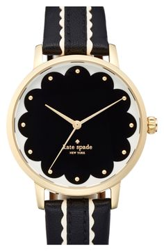 This lovely scalloped dial and striking leather strap give a touch of sweet glam to a classic round watch by Kate Spade.
