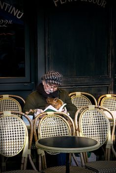 at the Paris café seats a man and his best friend! Awww so tender and sweet. Paris 3, I Love Paris, Café Theatre, People Reading, Steve Mccurry, Illustration, Airedale Terrier, Mans Best Friend, Dog Cat