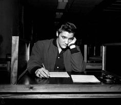 Elvis Presley during his Army pre-induction test at Kennedy Veterans Hospital in Memphis - January 4, 1957.