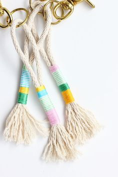 Learn how to make these DIY rope tassel keychains using simple household things like cotton rope, embroidery thread and a brass keychain.