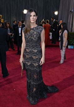 Sandra Bullock: Sandra Bullock wore an intricate black Elie Saab gown with all-over embellishment, then finished it off with a Swarovski clutch, Jimmy Choo heels, and Harry Winston jewels.