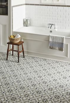 Bathroom flooring - how to mix traditional with luxury: Create impact in your bathroom, utility room or hallway with an intricate pattern that's great for a period-style property. Keep the look fresh with white walls and pared-back furniture. (Odyssey Grande range Epoque porcelain tiles (29.8cm x 29.8cm), £79.95 a sq metre, Original Style). Find more ideas at housebeautiful.co.uk
