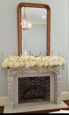 Beautiful mantle in cake room...Belle Bouquet Florist