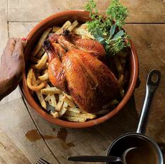 Christian Delouvrier's Roast Chicken with Herbed French Fries by Saveur. In this recipe by chef Christian Delouvrier of Manhattan's La Mangeoire restaurant, the secret to a perfectly moist bird with bronze, crisp skin is a basting of an umamirich mixture of soy sauce and butter.