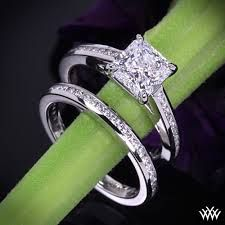 pretty much EXACTLY what i want. pretty princess diamond with diamond accents all the way around and a simple wedding band to match.