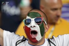 Italy fan with his face painted in the Italian flag colours cheers before their Euro 2012 quarter-final soccer match against England at the Olympic Stadium in Kiev. DARREN STAPLES/REUTERS