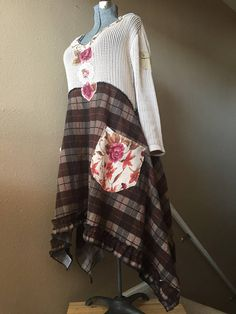Upcycled Refashioned Boho Gypsy Plaid Flannel Sweater Dress Ruffled Hemline Deep Scoop Neckline Floral Sweater Patchwork Appliqué 2 Big Front Pockets Nice Thick Brown Plaid Flannel Cotton Knit Sweater with little cargo pocket on sleeve Asymmetrical Hemline Size medium Measured with