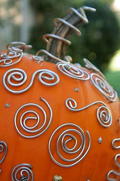 The Studded Wire Pumpkin.  This is really good when you want to eat the pumpkin after Halloween, and you can save the decorations for another year.