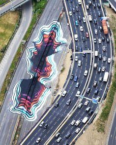 Street Art – 1010 réalise une illusion gigantesque sur le périphérique parisien
