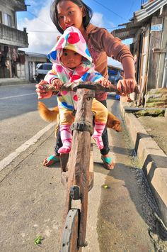A young Kalinga girl with her sibling riding a wooden scooter. Wooden Scooter, Camera Obscura, Project 365, Photo A Day, Sibling, Creative Words, How To Take Photos, Cowboy Hats, Challenges