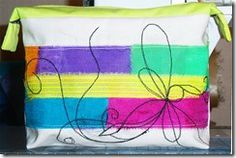 Zipped calico pouch - strips of procion dyed fabrics with machine embroidery - dragonfly