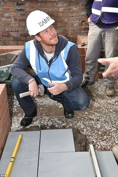 While William went into one house to start painting, Harry was invited to pick up some heavy concrete slabs and lay them in concrete in a nearby garden