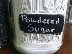 Easy DIY to organize your kitchen! Chalkboard paint onto jars for easy, changeable labels!