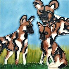 """African Wild Dog Ceramic Wall Art Tile or Trivet 8""""x8"""" by J Designs. $29.99. Raised Relief Wall Art. Hang on the wall, use as a trivet, use the built in stand for shelf use. Hand Painted, Colors will never fade. Grout into your tile backsplash. Beautiful High Gloss Raised-Relief, Hand-Painted African Wild Dog Tile. Each Tile has a cork back and hanger. Great as a coaster or wall hanging. These tiles look great in a kitchen, bath, or even a child's room. Great Gift Item! ..."""