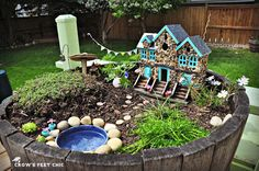 DIY Love, love, LOVE this fairy garden in a barrel. Wonderful details.