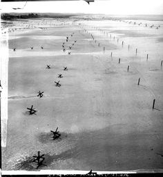 A friend from work whose Dad flew F-5's (P-38) during the war, his name was Walter Burke and he received the DFC. The recon photo's are ones he took, including pre-invasion Normandy