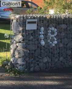 Gabion wall using rocks for house number Gabion Wall, House Numbers, Rocks, Landscape, Ideas, Garten, House Number Plates, Scenery, Landscape Paintings