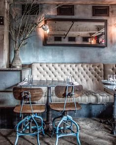 Smith & Mills is a stamp-size bar occupying a former stable in NYC's Tribeca. Go for drinks, and split the burrata.