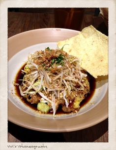 Tahu Telor (deep fried tofu serve with special soybean sauce and sprouts and sprinkle with finely crushed peanuts) Copyright Vivi Kembang Tanjoeng