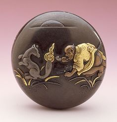 Oyama Motozane IV (Japan, died 1916)   Fox Fire, late 19th-early 20th century  Netsuke, Silvered bronze, mixed metals; manju type,