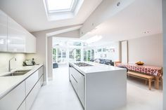 Single-storey kitchen extension in Twickenham by L&E (Lofts and Extensions) - don't move extend. Pitched Roof, Kitchen Extension, Kitchen Design Ideas, Skylight, White Kitchen