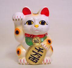 Maneki-neko (gato japonés de la buena suerte)