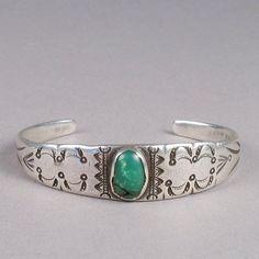 Pueblo cuff bracelet with green turquoise cabochon c 1915