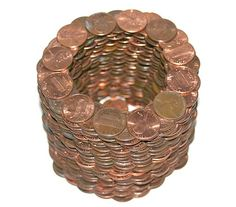 When counting a pile of coins, you can count them without counting them. For example, a penny weighs 2.5 grams. If this stacked weighed 2,500 grams, then that means this stack contains 1,000 pennies.  In dimensional analysis we do it this way:  2,500 grams x   1 penny = 1,000 pennies 2.5 grams By the way, a nickel weighs 5.00 grams, which is easy to remember (5 cents / 5 grams).