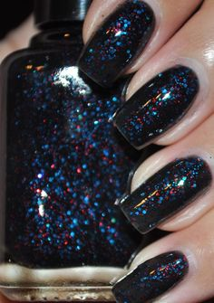 Twenty Ten is small square red glitter, microfine and small blue hex glitter in a sheer black base. $9.25 // I really want this! I've been really into black polish with glitter over it lately, and the sheer base creates a cool multi-layer effect.