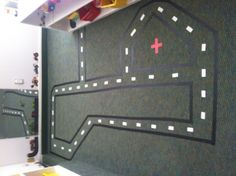 Masking tape road for your transportation area :)