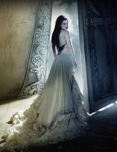 Amy Lee of Evanescence on the cover of their second album 'The Open Door' - Amy designed the dress she's wearing.