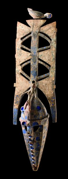 """Africa   Mask """"nwenka"""" from the Bobo people of Burkina Faso   Wood, paint, indigo blue pigment    the """"nwenka"""" mask is one of the oldest and most sacred wooden masks that perform at Bobo masquerades. Tradition claims it dated from the time of creation when """"wuro"""", the Creator God, molded the world from moist clay and made creatures to inhabit it.  The """"nwenka"""" masked dance imitates """"wuro's"""" creating the world."""