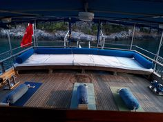 back of the ship used as yoga space for 10 people.