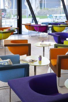 Stua furnishes Wien University by Zaha Hadid -  Nube armchairs and Marea tables