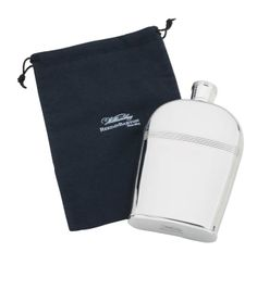 Presented in a handsome black flannel storage bag, the Hob Nob Flask and Bag from Williamsburg by Reed & Barton makes for a special gift for any occasion. Perfect for toasting together like hob nob suggests, this silverplated flask is both durable and functional. Part of the Williamsburg Hob Nob Collection.    Classic  Includes flannel bag  Non-tarnish stainless steel  Suitable for engraving  H. 6 18, Cap. 8oz  For Personalization e-mai: contactusMyStyleWine
