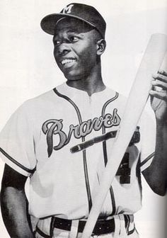 """Henry Louis """"Hank"""" Aaron (1934-), Negro League and Major League Baseball player.  Most homes runs (755), most runs batted (2,297), and most games played (3, 298)."""