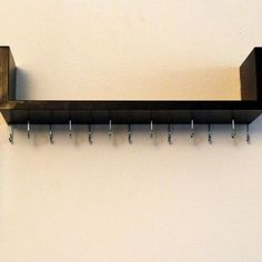 Wall-Mounted Necklace Organizer & Jewelry Shelf. Hang necklaces, stack bracelets on the shelf.