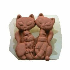 Wholeport Cat Lovers Translucence Silicone Handmade Chocolate Molds by Huadong Trading. $3.99. Size: 6.5cm*5.5cm*1cm. Material: Silicone. Food-grade (FDA standard). Heat Resistant Temperature -40 to +230 Centigrade. Good quality  Color & Style representation may vary by monitor. Can be reused, Easy to use and clean.