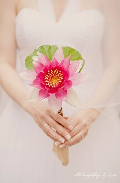 Wedding Bouquet...don't know how they did this. That is a water lily!!!