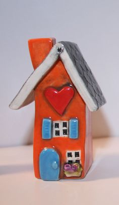 Orange House with an arched Blue door. ooak. HeartHomes